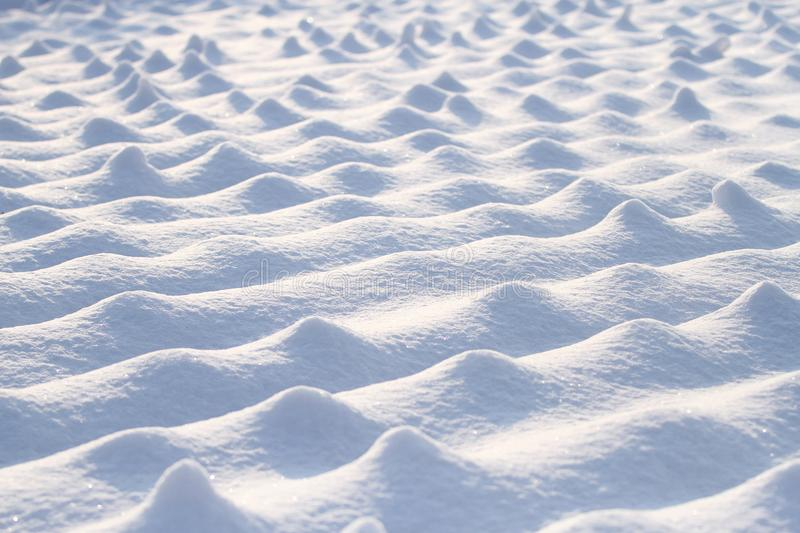 White snow on feild in sunlight. In winter, abstract background royalty free stock photography