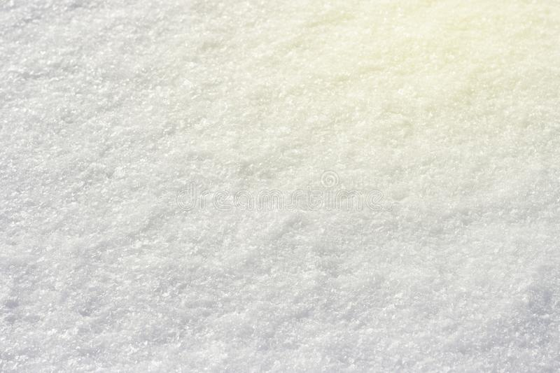 White snow shining in the sun close-up texture natural background, toned.  royalty free stock photography