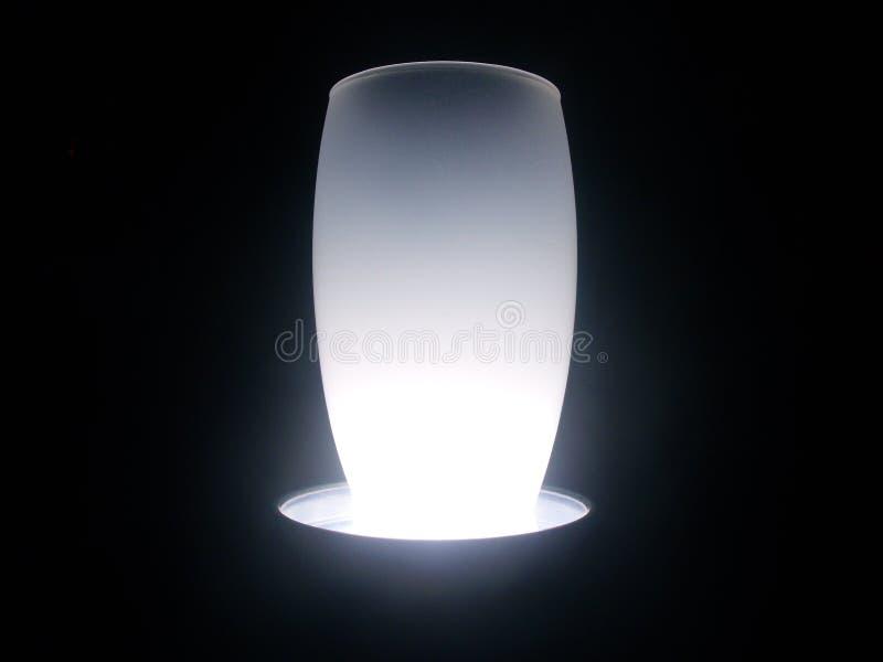 White snowed vase illuminated stock photos