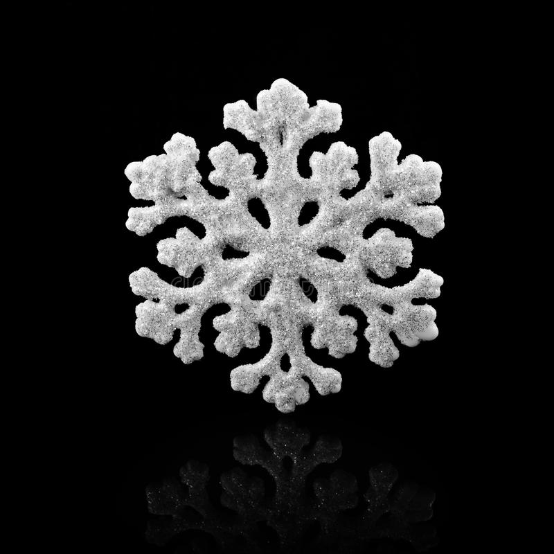 White Snowflake on black background. Winter symbol.  royalty free stock photography
