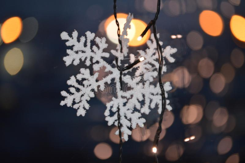 White Snowflake with bokeh Christmas lights stock photos
