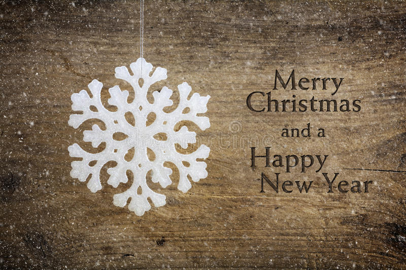 Download White Snowflake Star Hanging Over A Rustic Wooden Background Stock Photo