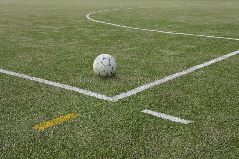 Soccer ball on sports field at boundary line royalty free stock images