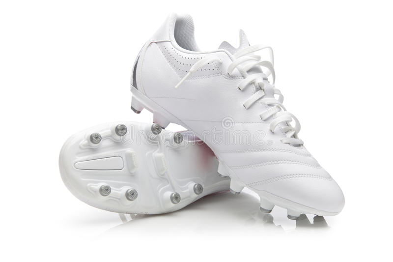 White Soccer Boots royalty free stock photography