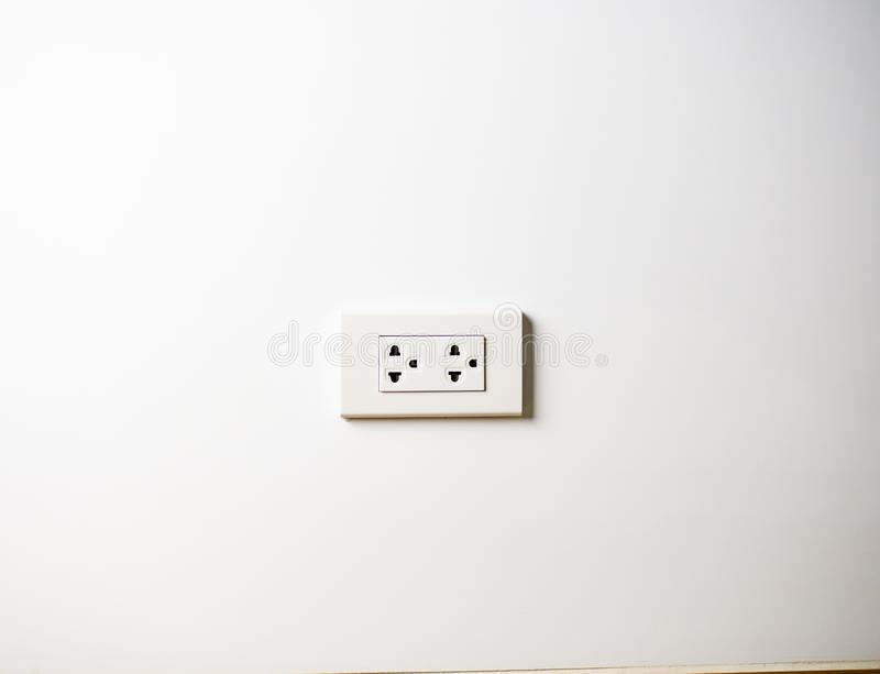 White socket 220 volts on white wall, unplugged.  royalty free stock photography