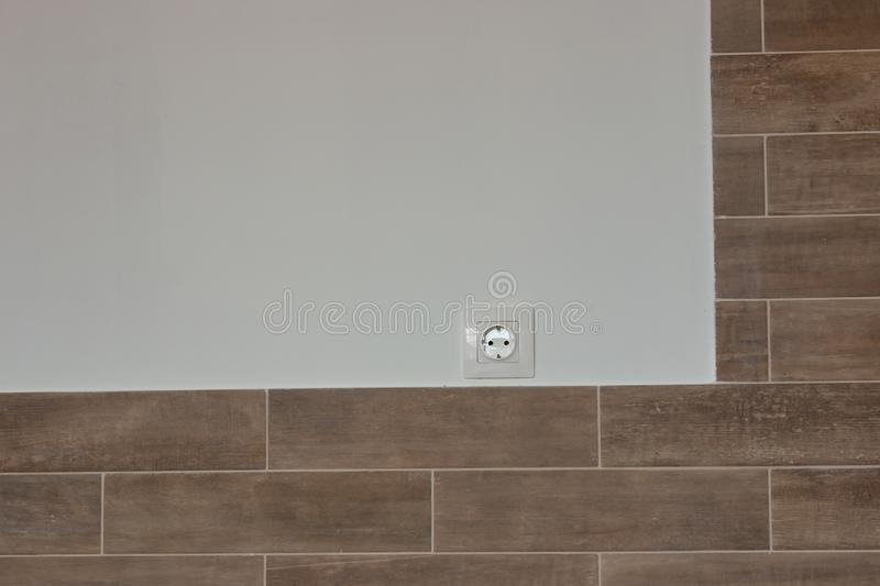 White sockets and switches on the wall being repaired royalty free stock images