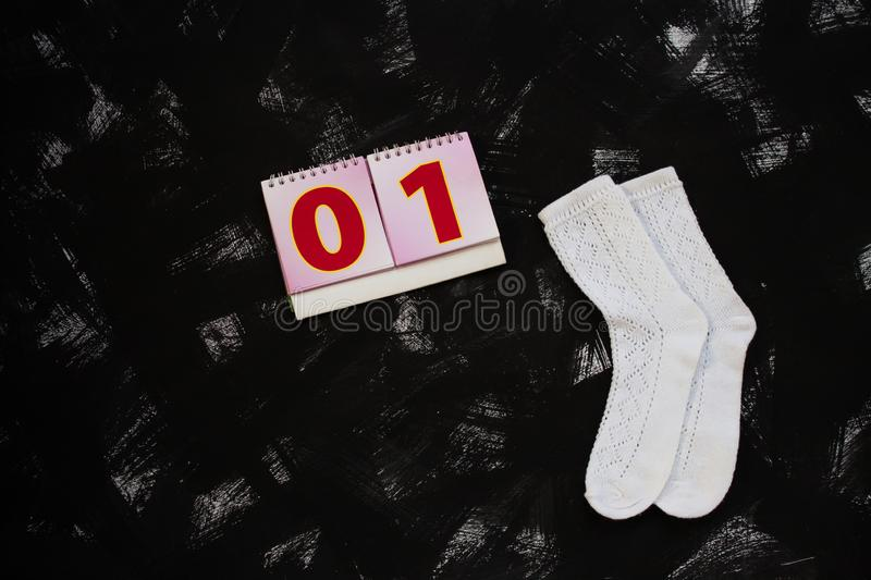 White socks and school supplies on black background. The first of september. Back to school concept stock photo