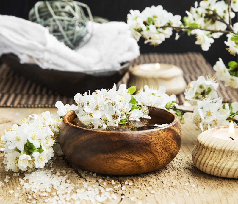 White Spa Flower Blossom in a Wooden Water Bowl.Beautiful Spa Tr. Spa White Flowers Blossom with Wooden Water Bowl on Wooden Background.Wellness and Spa stock photos