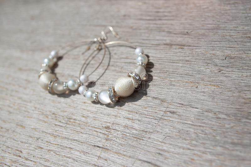 White sparkle earrings for the bride stock photo