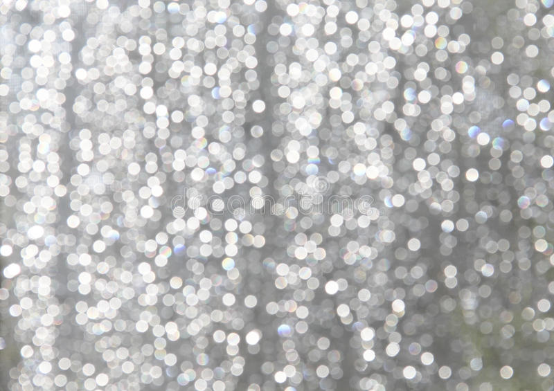 White Sparkles with lite Blue Gray Background royalty free stock images