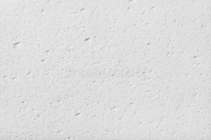 White sponge. White cleaning sponge texture. Close up. Top view stock image