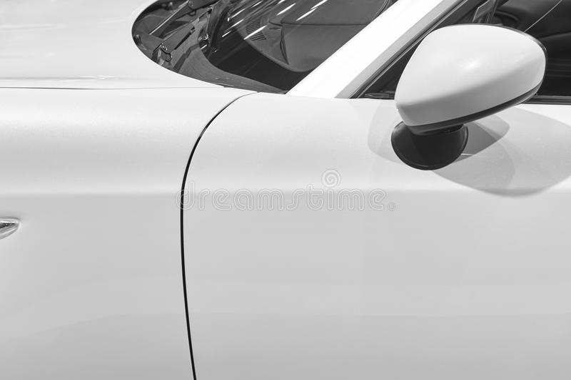 White sport car detail. Door windscreen and mirror royalty free stock image