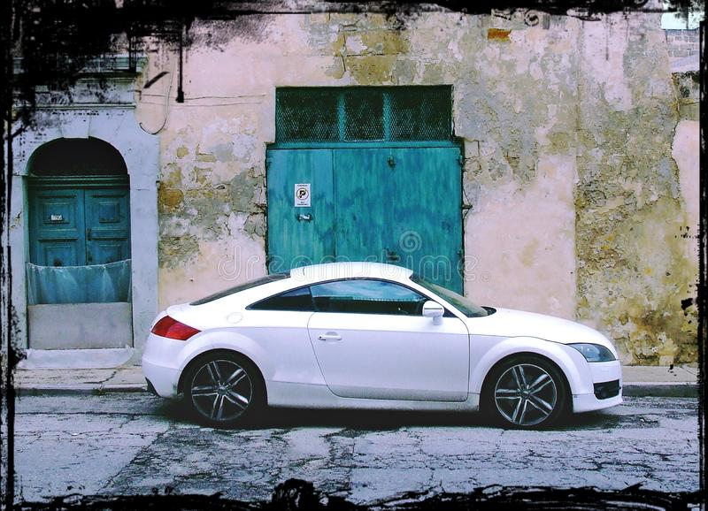 Modern Car, Old Buildings, No Parking stock photography