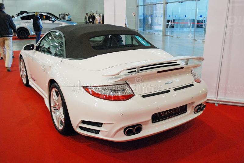 The white sports car Porsche 911 991 with tuning from Mansory at an exhibition in `Crocus Expo`, 2012. Moscow stock photography