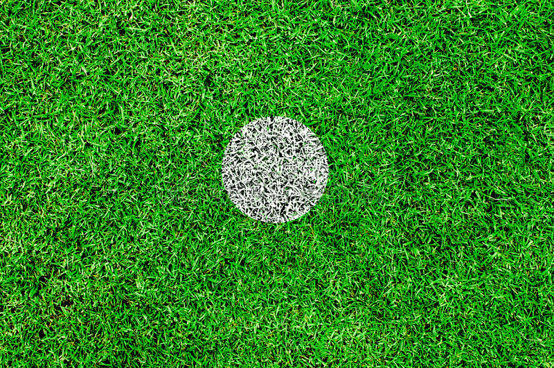 The white spot on a football pitch. Center spot,penalty spot stock photos