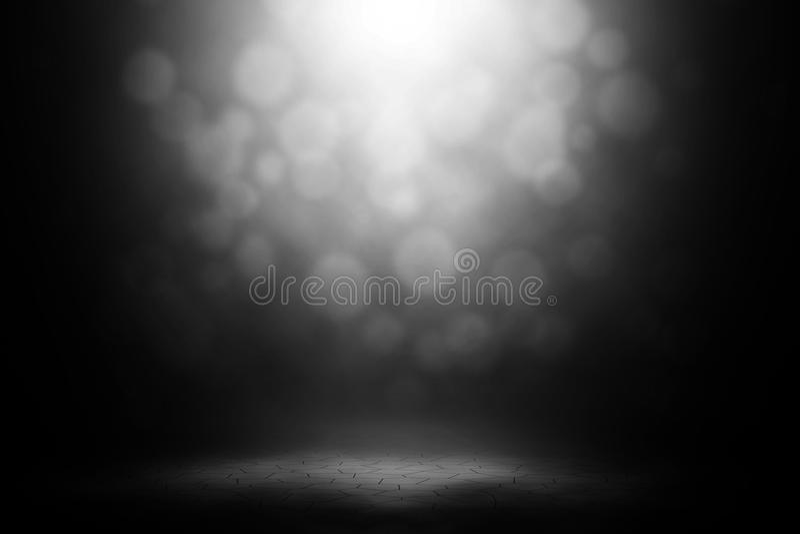 White spotlight spotlight bokeh on brick floor. royalty free stock photography