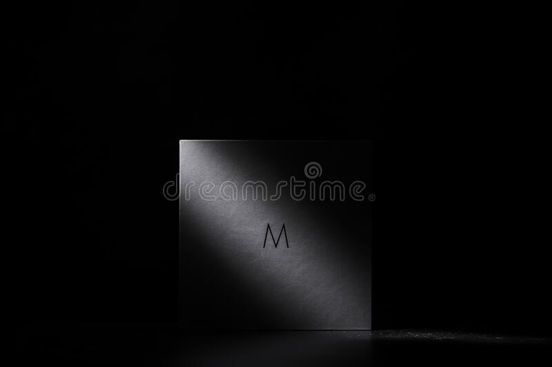 White square bathed in light stock photography