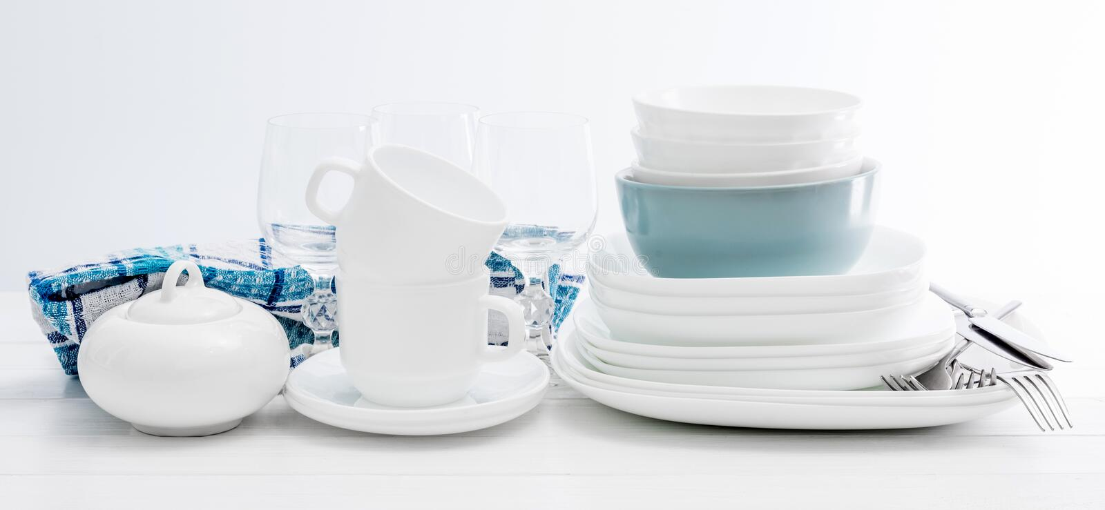White square dinnerware set with glasses stock photos