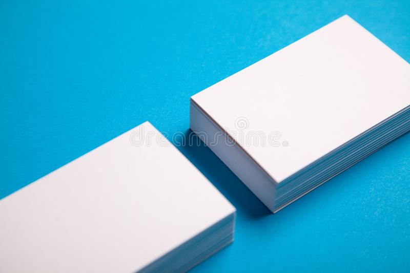 White stacks of business cards on blue background royalty free stock images