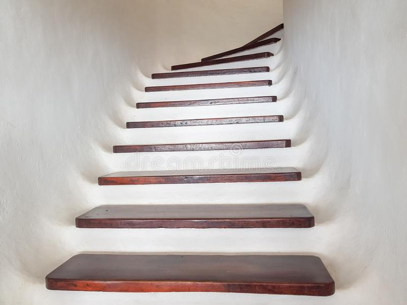 white staircase design with wooden steps. Upward view royalty free stock photos
