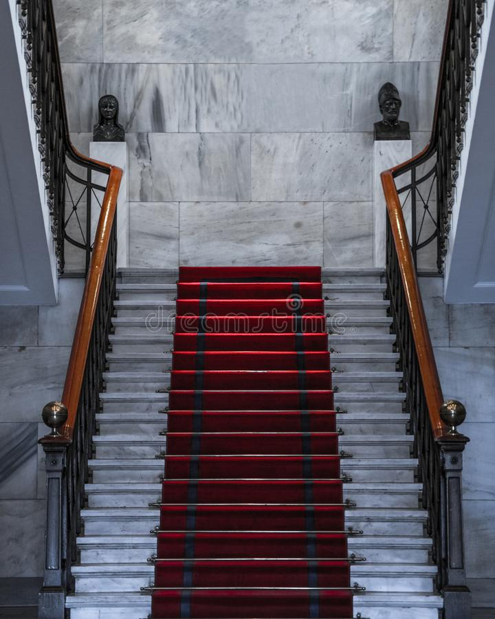 White Staircase with Red Carpet on top stock photo