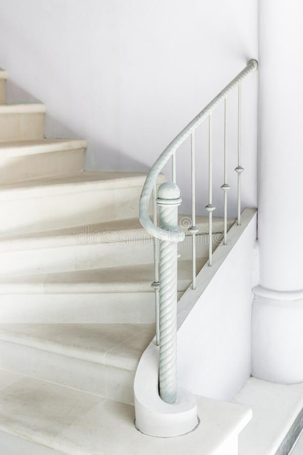 White stairs with vintage white railing. Minimalist white interior. White stairs with vintage white railing. Bright and minimalistic interior stock photos