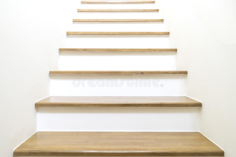 White Stairs on wood and white wall royalty free stock photo