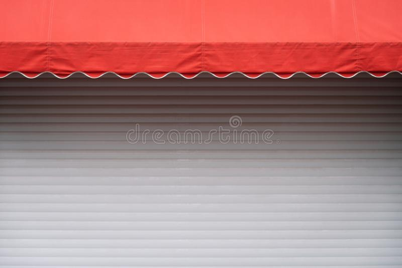 White stall with red sunshade royalty free stock photography
