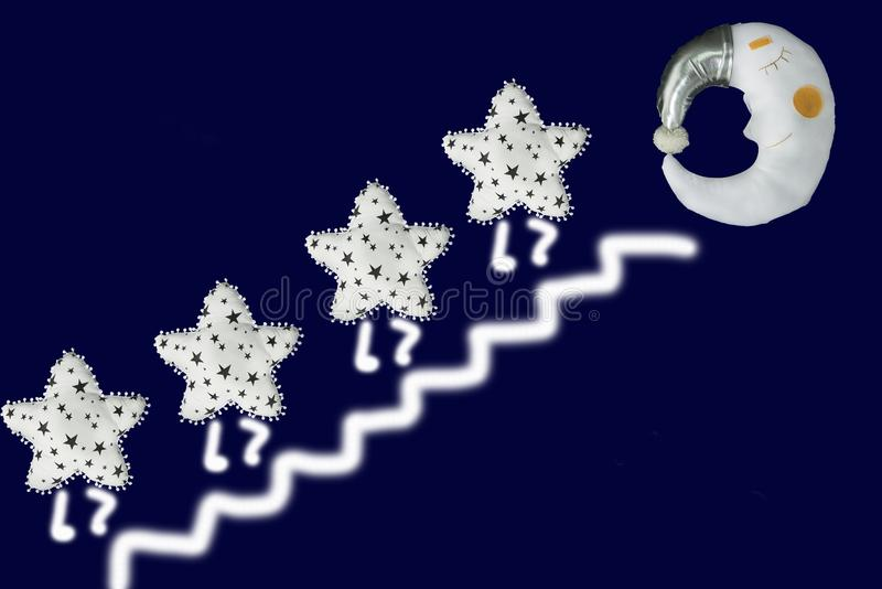 White star go up the stairs to sleeping moon in silver bonnet on navy blue background.  stock photo