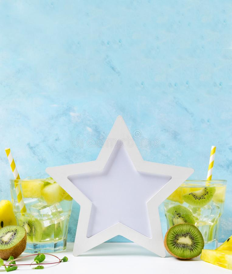 White star Photo frame mockup: cool and fresh kiwi watermelon lemonade with ingredients on blue background. Vegetarian food, heal stock images