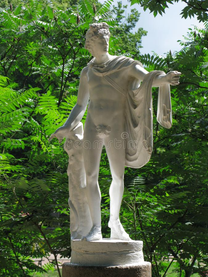 White statue of Apollo Belvedere in the garden royalty free stock photos