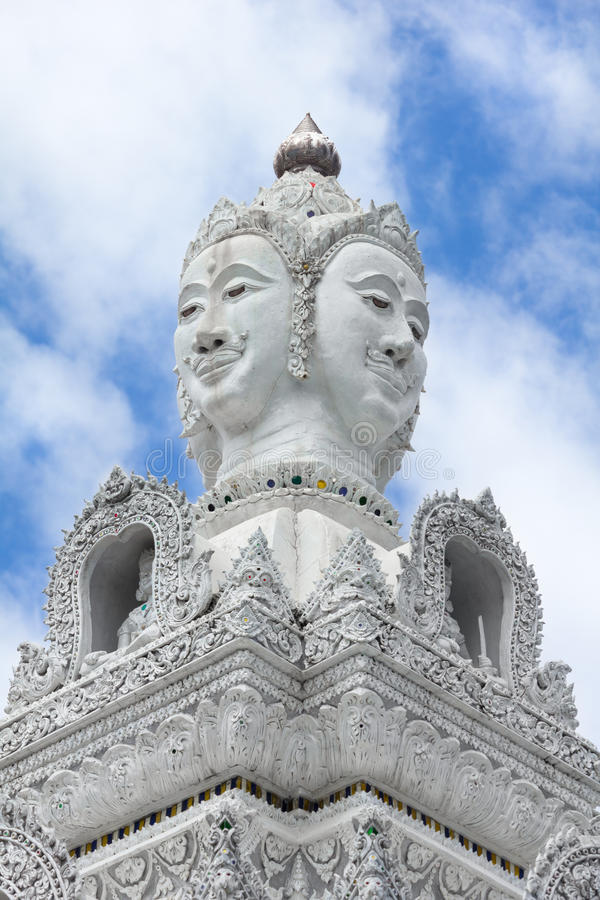 White statue of buddha image with blue sky and cloud royalty free stock images