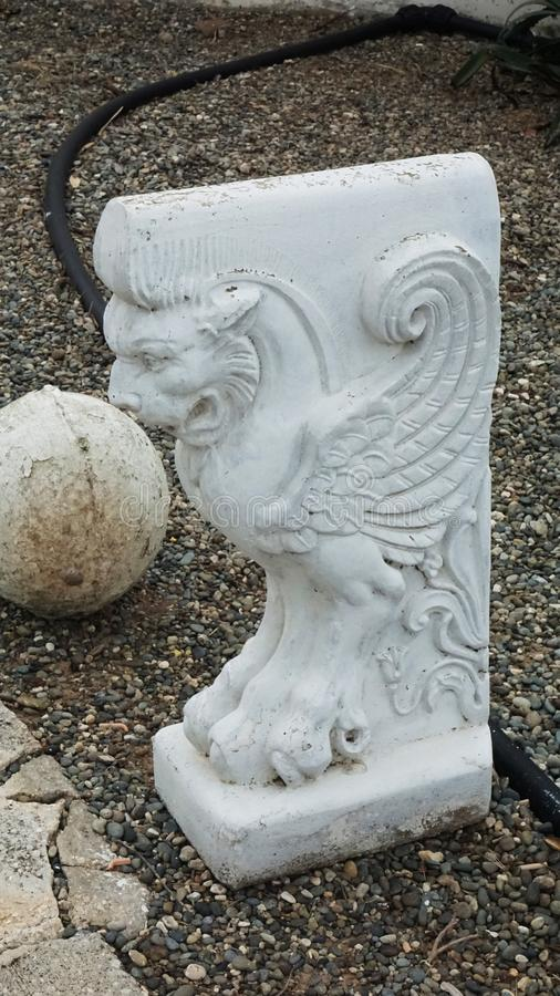 White statuette in the form of a mythical lion with wings in Cyprus. Figure royalty free stock photo