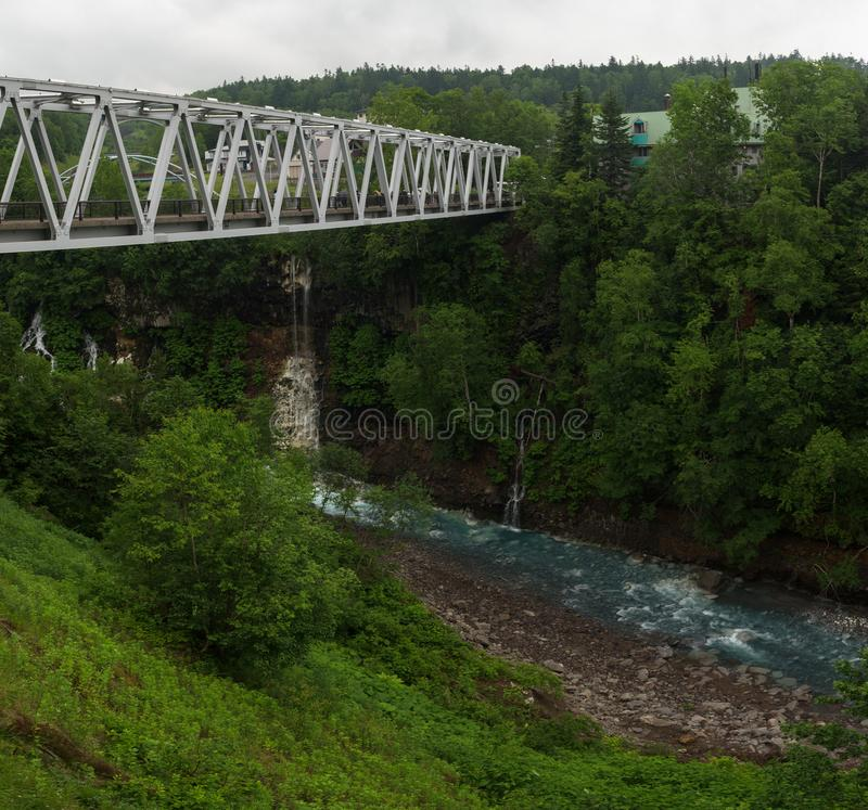 White steel bridge crossing a river. Biei, Hokkaido, Japan royalty free stock photos