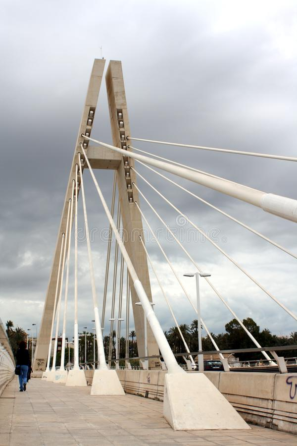 A white steel cable-stayed bridge that is called as `Generalitat Bridge`in Elche city, Spain stock images