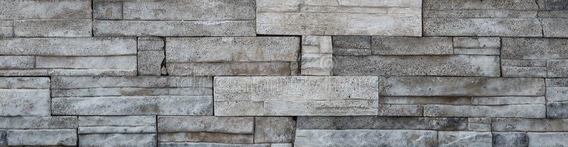 White stone bricks texture, rocky wall closeup. White stone bricks texture, rocky wall surface closeup. Grunge rock backdrop, building decoration royalty free stock photo