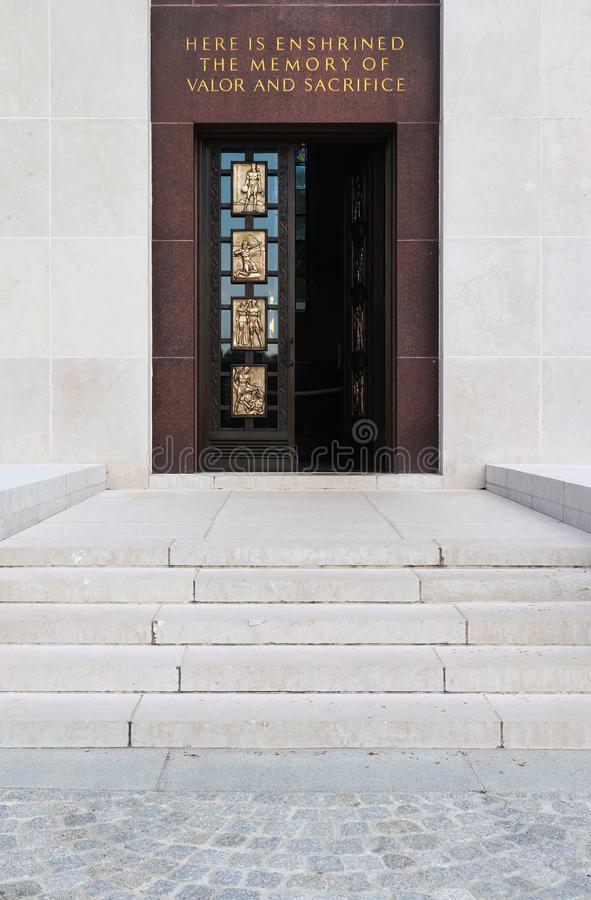 The white stone chapel door at the Luxembourg American Cemetery and Memorial. Steps leading up to the door on the white stone chapel at the Luxembourg American royalty free stock photo