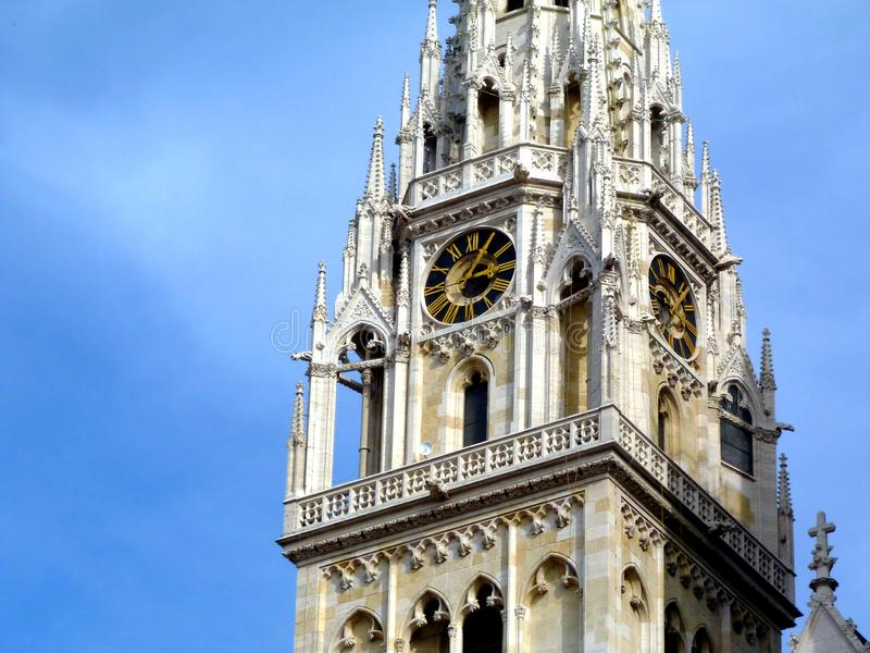 white stone church clock and bell tower detail in Zagreb stock photography