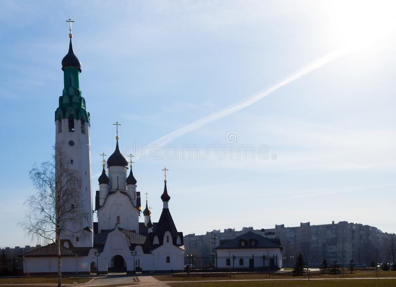 White stone Church on a Sunny day against blue sky and sun-image royalty free stock photos