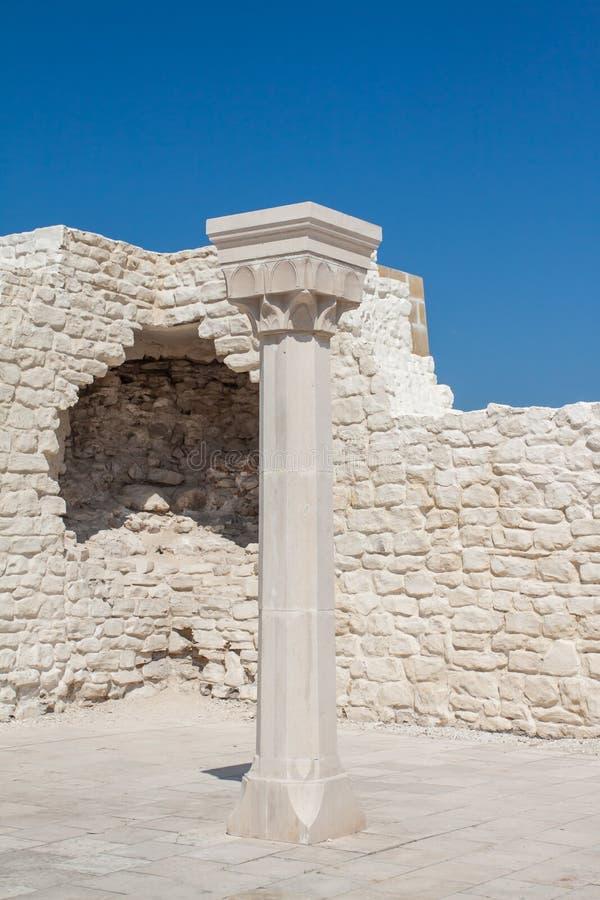 White stone column inside the ruins. stock image