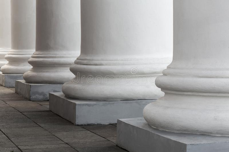 White stone columns of the old building. The facade of the theater royalty free stock image