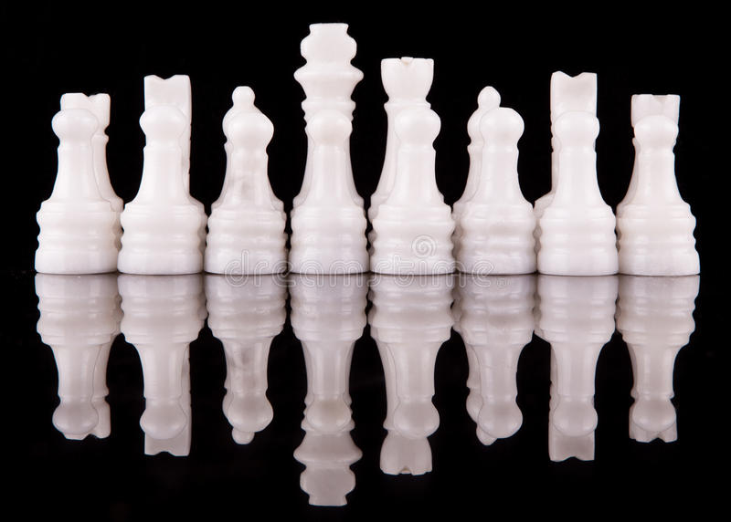 White Stone Made Chess Set I. White pieces of stone made chess set on black background royalty free stock photos