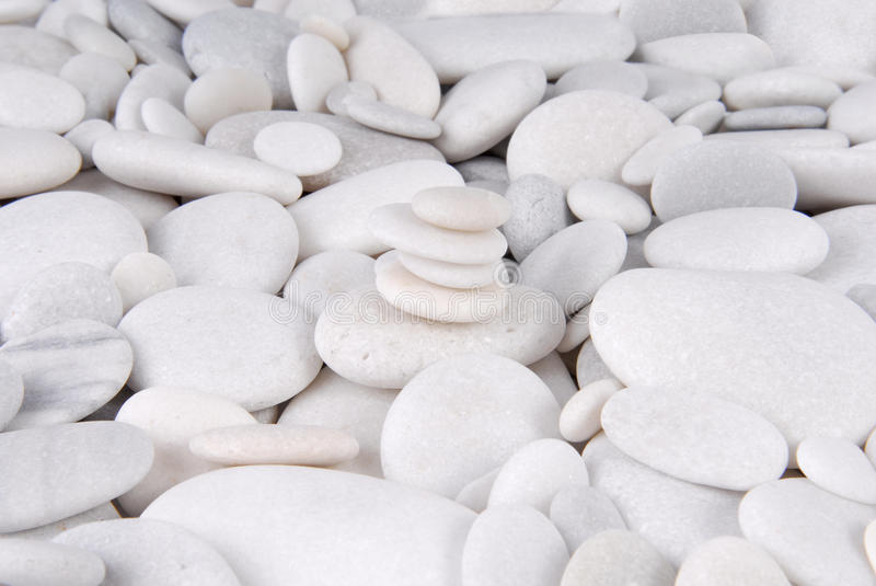 White stone pebbles concept. Close up of the white stone pebbles concept royalty free stock photo