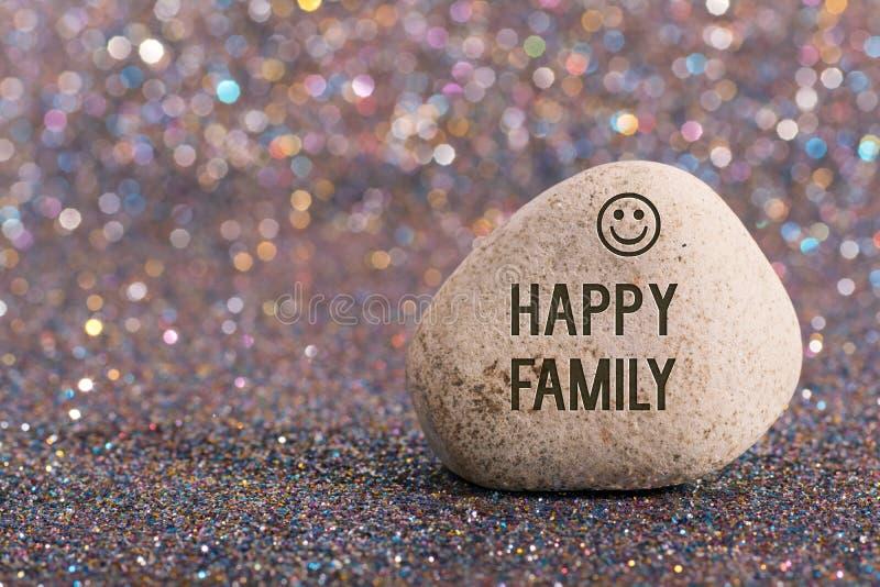 Happy family on stone royalty free stock photos