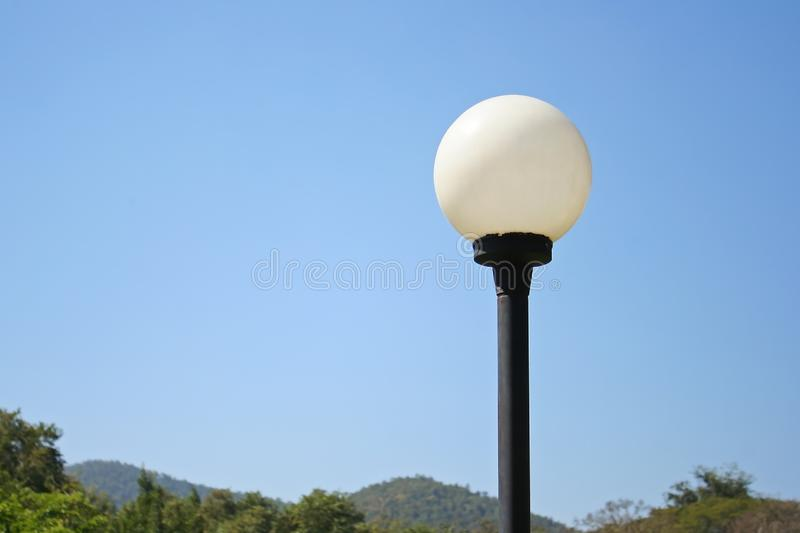 White street lamps and vivid blue sky stock photos