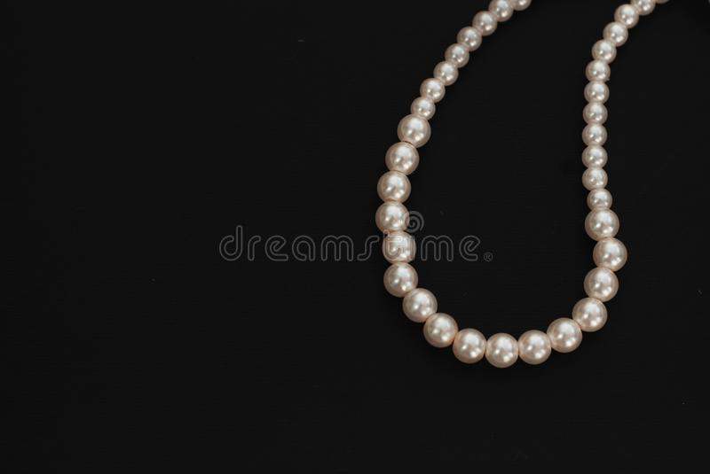 White String Pearls necklace, isolated on black Copy space stock images