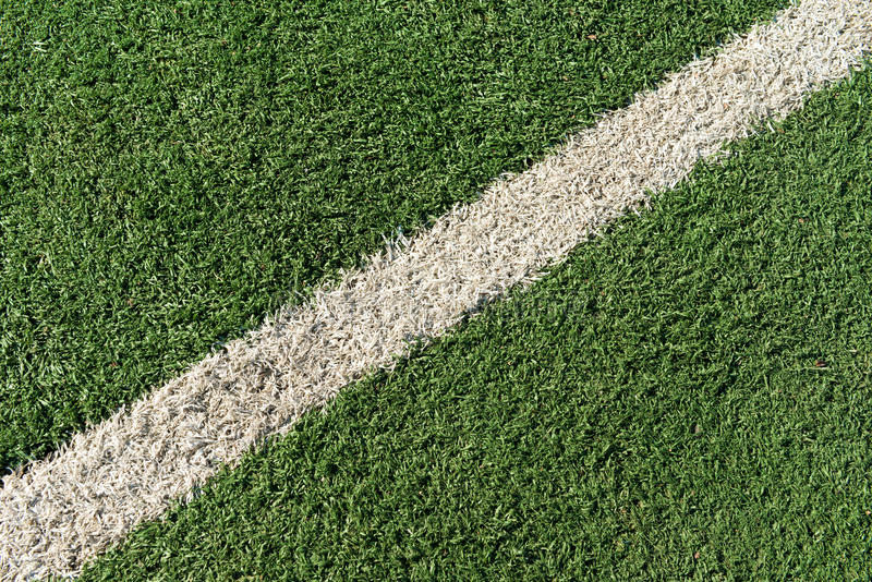 White stripe on the green grass. White stripe on the green tennis field from top view royalty free stock images