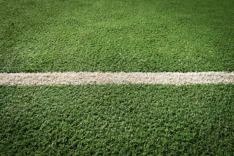 White stripe on the green grass. White stripe on the green tennis field from top view stock photos