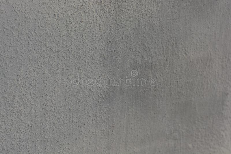 White structural plaster for outdoor use, street wall background with its structure. stock photos