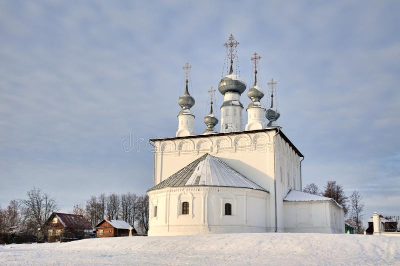 The White Sts. Peter and Paul Church on a Small Hill Covered Snow royalty free stock image